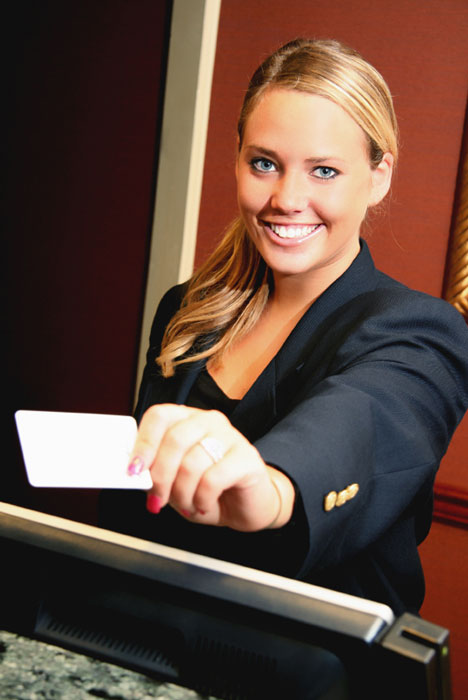 Concierge handing out a hotel room key.